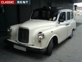TAXI Anglais Londonien - Carbodies - 1991 - Blanc